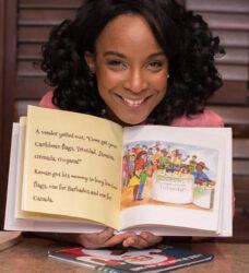 Yolanda Marshall shows off her children's book.